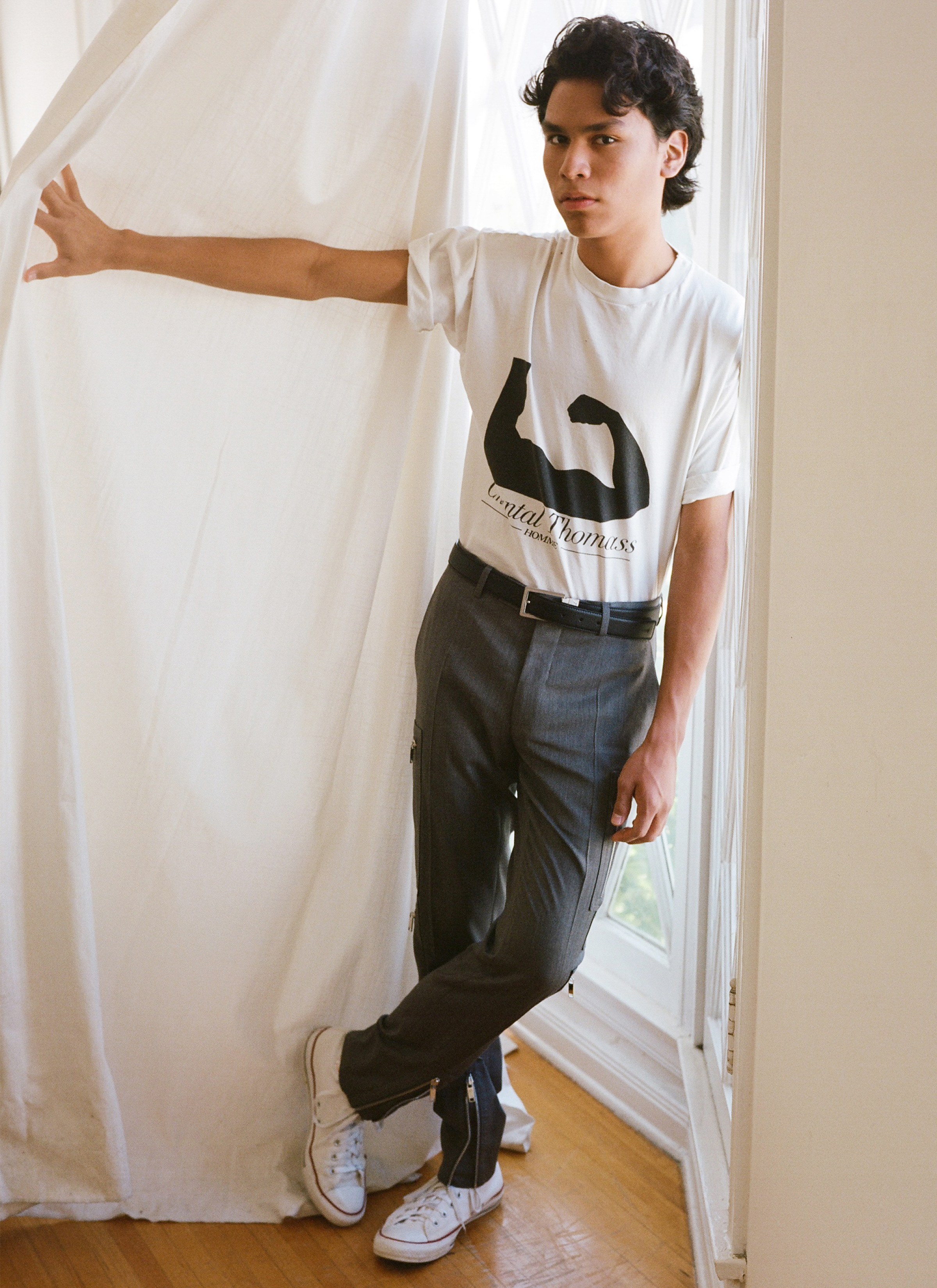 T-shirt, vintage Chantal Thomass from Chapel NYC. Trousers and belt by Dior Homme. Sneakers by Converse.