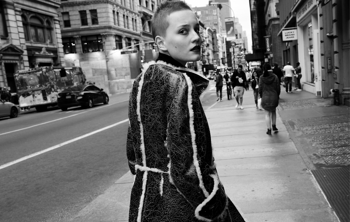 Lina Hoss wears coat by Véronique Leroy. Sweater by Wolford.
