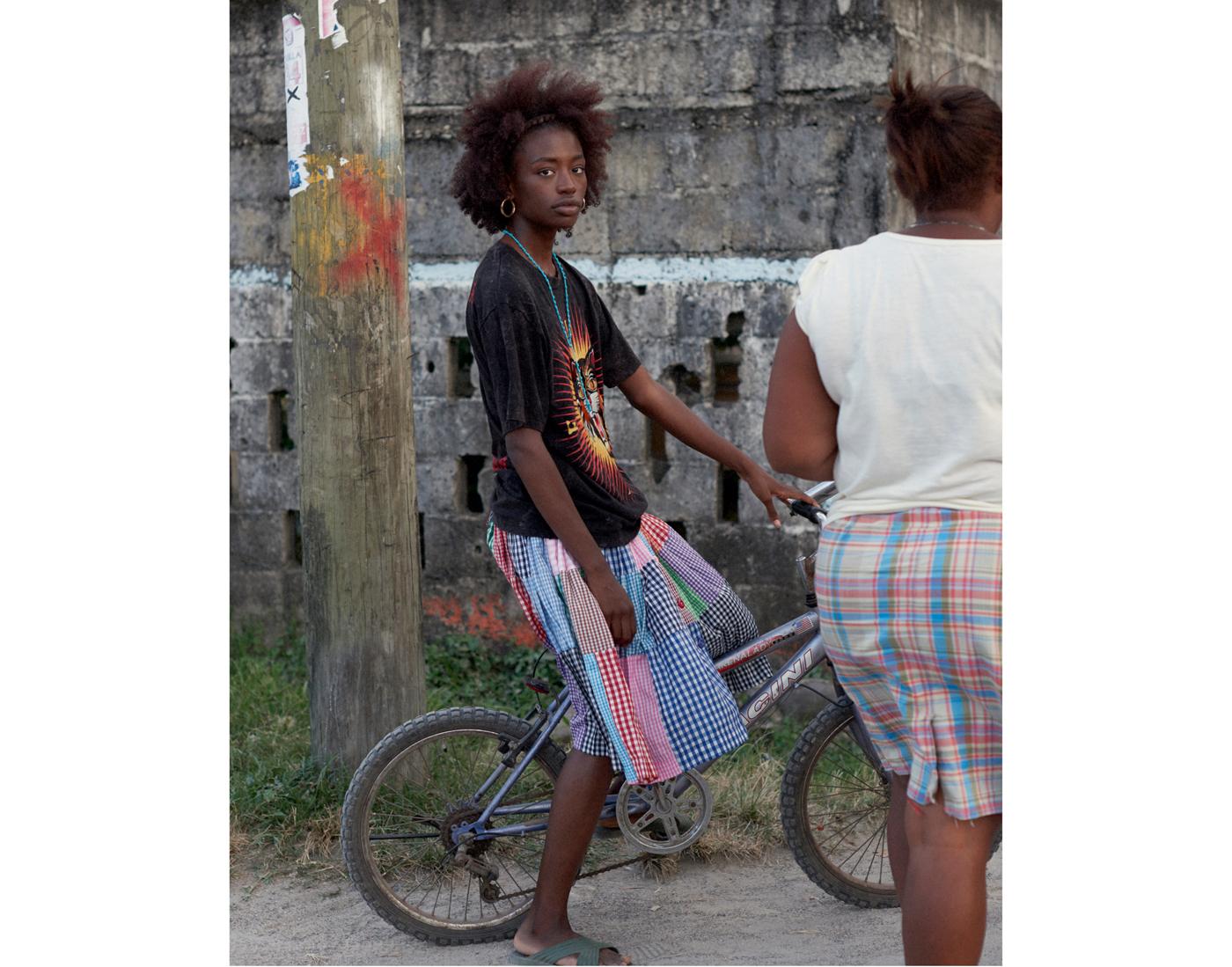 T-shirt by Gucci. Traditional Garifuna skirt.