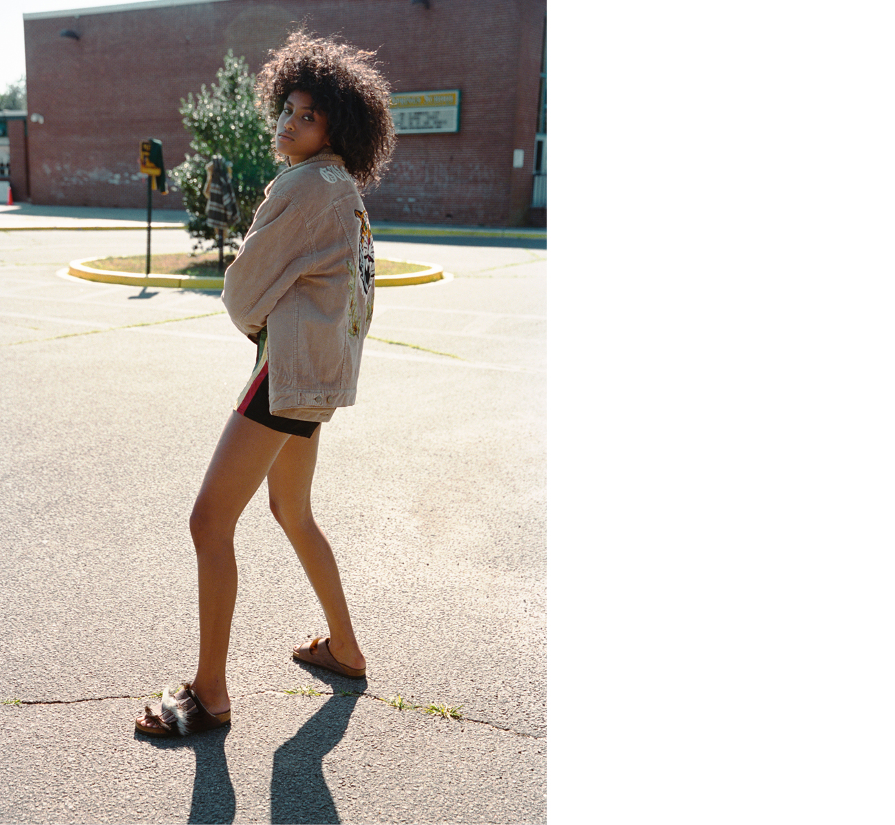Jacket by Gucci. Vintage shorts from Southpaw Vintage, New York. Sandals by Birkenstock.