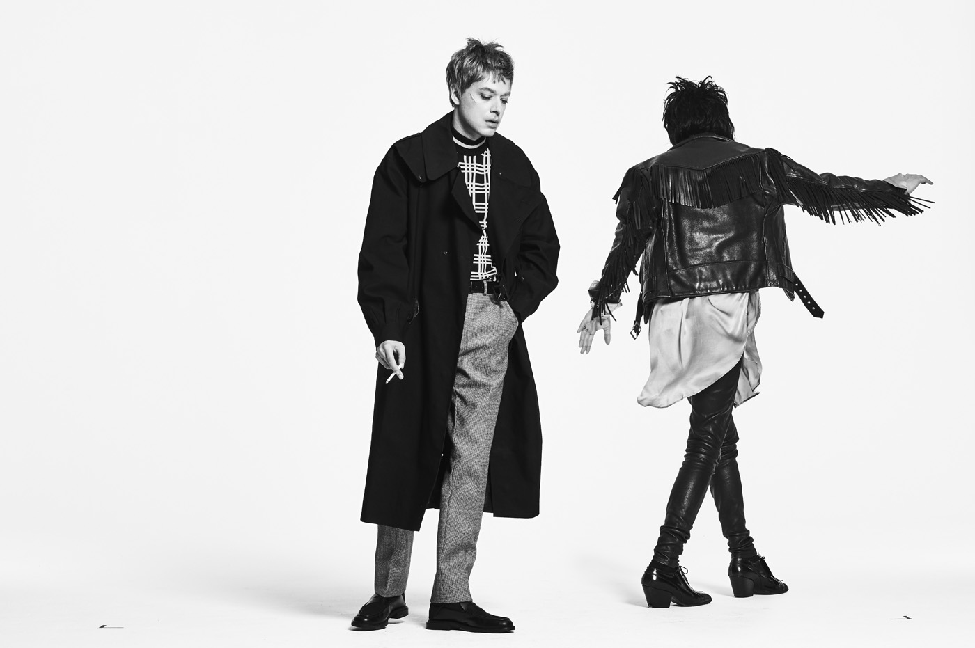 From left, Hooky wears vintage coat from Early Halloween, New York. Sweater, trousers, and shoes by Fendi. Orion wears vintage jacket from What Goes Around Comes Around, New York. Shirt by Ann Demeulemeester. Trousers, vintage Vivienne Westwood boots, and earring, stylist's own.