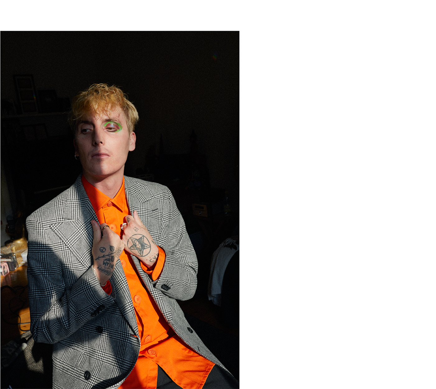 Jacket by Oscar Jacobson. Top by Schnayderman's. Trousers by Acne Studios. Bracelet, talent's own. Rings by All Blues.