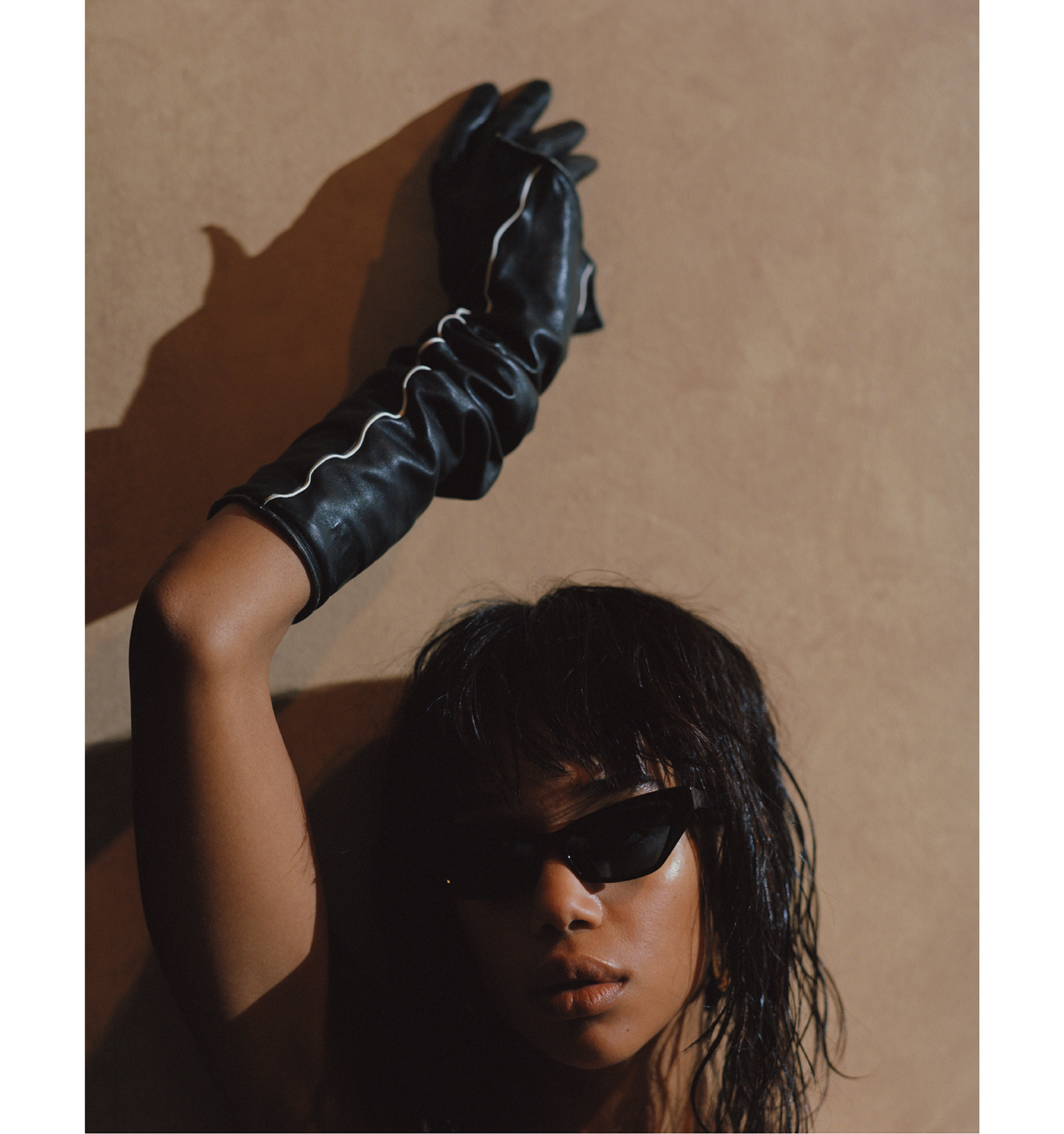 Sunglasses by Alain Mikli. Glove by Louis Vuitton.