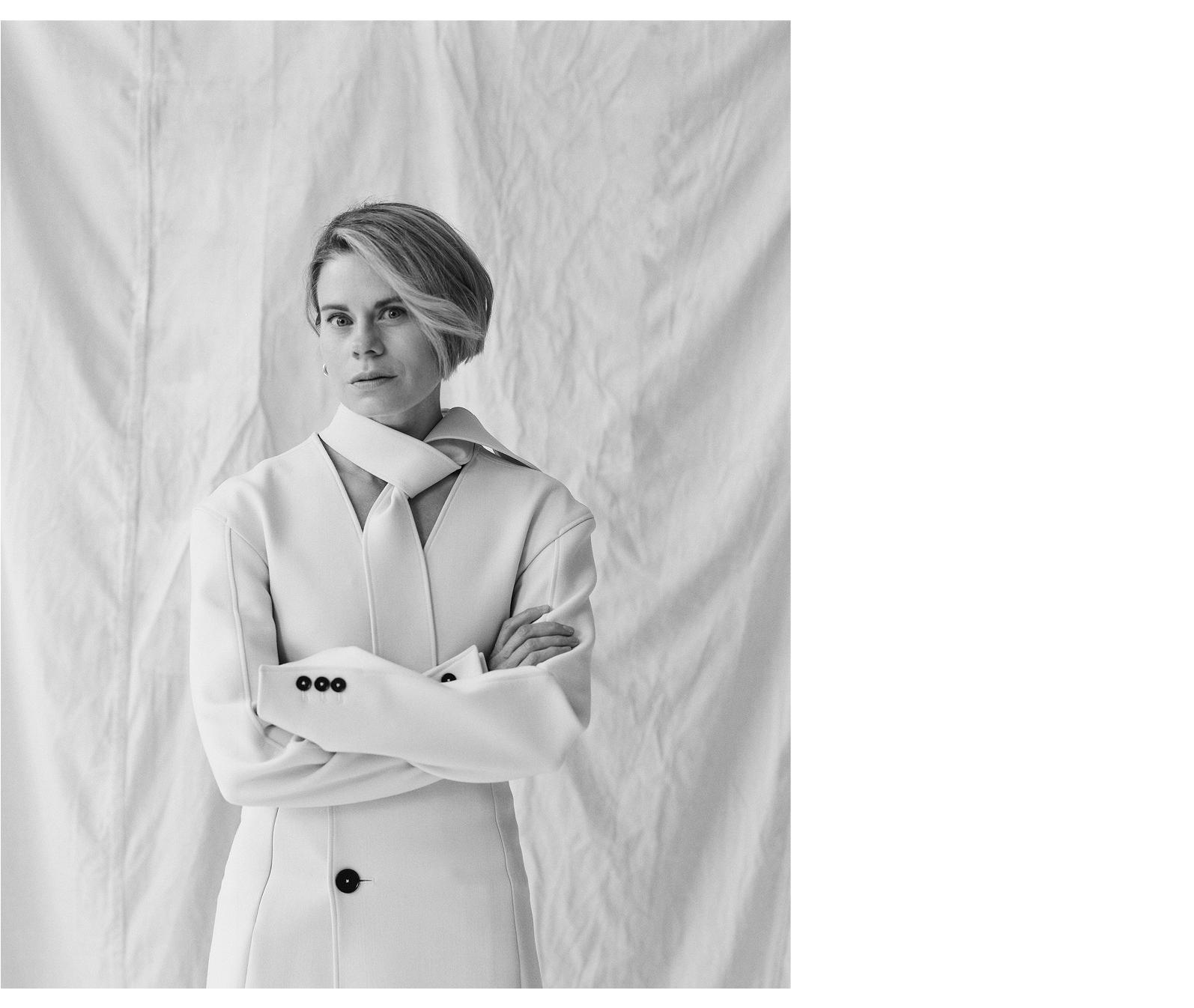 Jacket by Jil Sander. Earrings by Sophie Buhai.