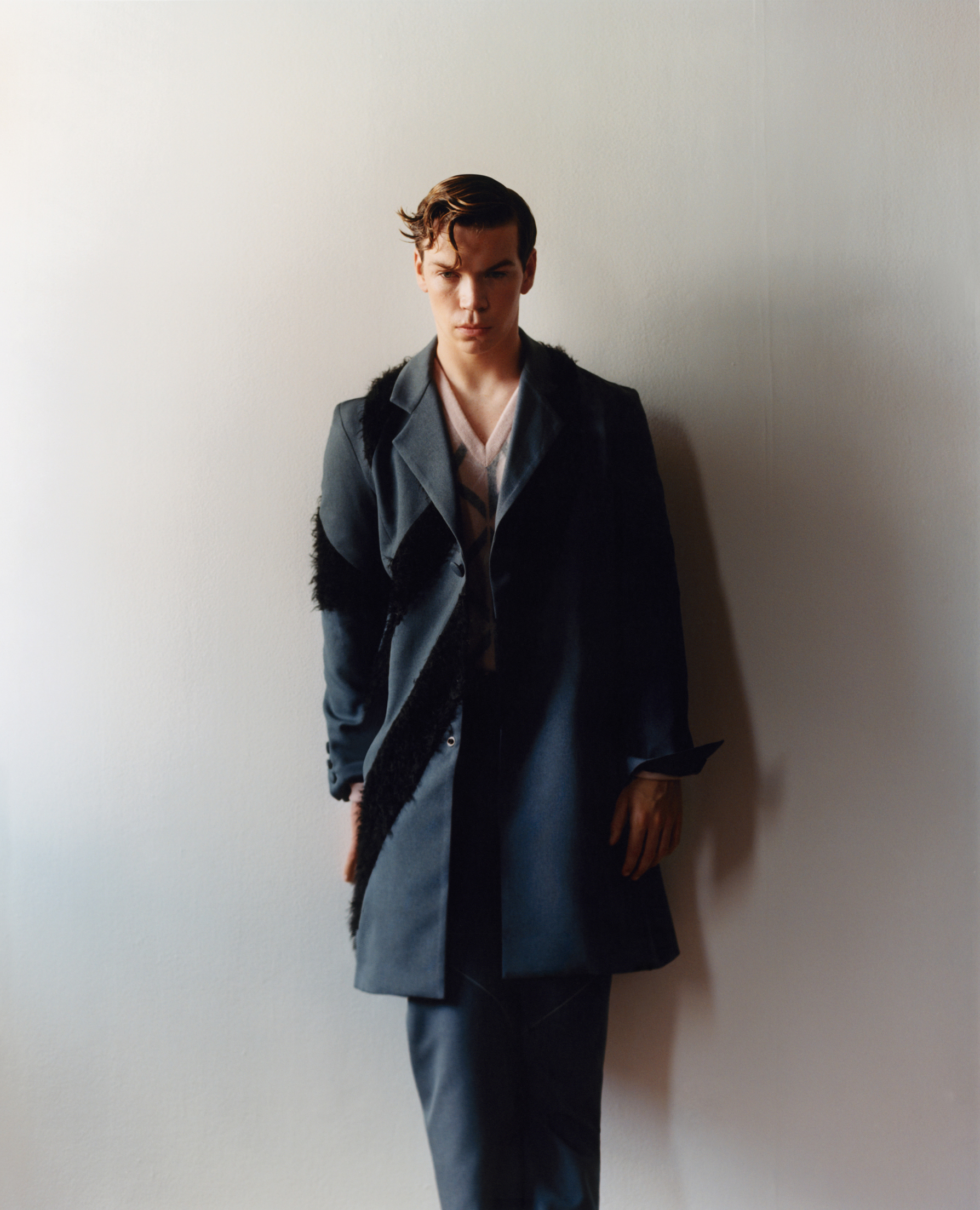Coat and trousers by Kiko Kostadinov. Sweater by Dior Men.